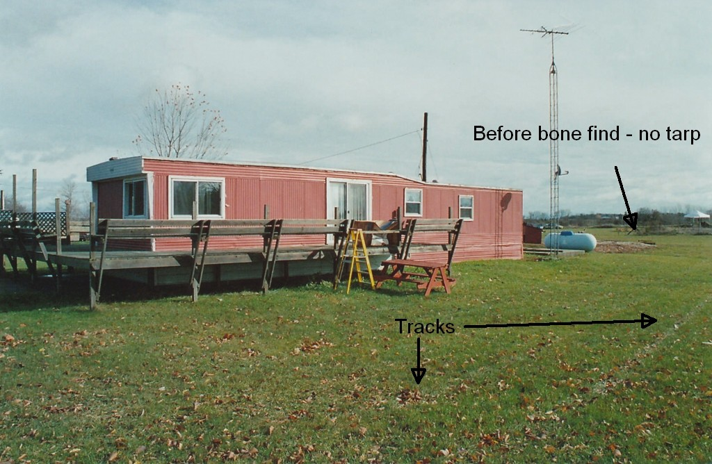 Early photo of rear of trailer before bone discovery